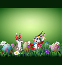two easter bunnies with easter eggs in a field vector image