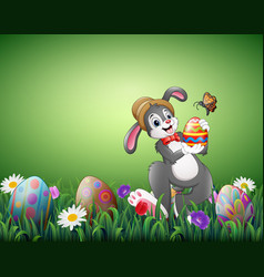 happy easter bunny holding easter eggs in a field vector image