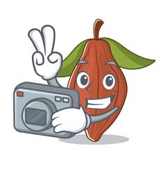 Photographer cacao bean mascot cartoon vector