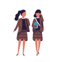 pair of girls dressed in school uniform female vector image