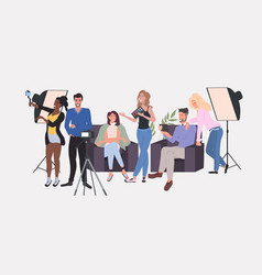 Beauty bloggers recording video blog with camera vector
