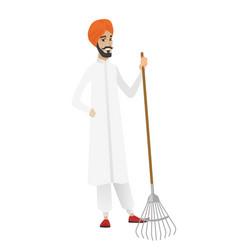 Young hindu farmer holding gardening rake vector