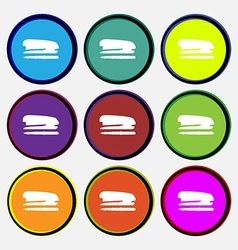 Stapler and pen icon sign Nine multi colored round vector