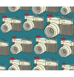 Seamless pattern with old photo cameras vector image