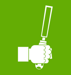 chisel tool in man hend icon green vector image