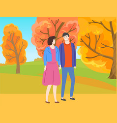 Man and woman walking in autumn park among trees vector
