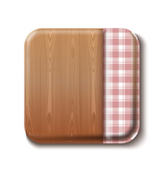 Wooden table covered with a checkered tablecloth vector