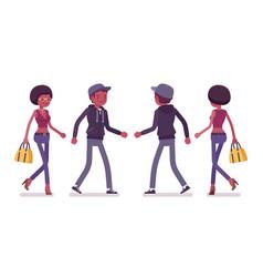 Young black man and woman walking vector
