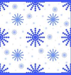 seamless pattern from falling blue snowflakes of vector image