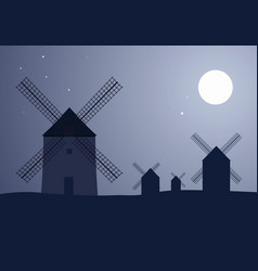 Typical spanish windmills under the moon and stars vector