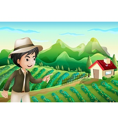 A boy pointing at the barnhouse at the farm vector