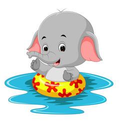 Funny elephant swimming using ringball vector