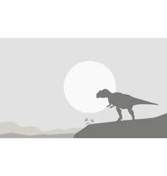 Silhouette of mapusaurus on the cliff vector
