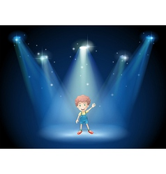 A boy waving his hand at the stage with spotlights vector