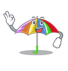 Okay rainbow umbrella isolated on a mascot vector