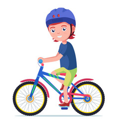 Boy rides a bicycle in a protective helmet vector