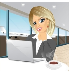 businesswoman working at laptop at airport vector image