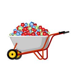 wheelbarrow and gems treasures in garden trolley vector image