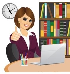 Businesswoman making thumbs up gesture vector