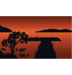 Pier and tree silhouette vector image vector image