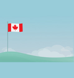 canadian flag waving against blue sky vector image