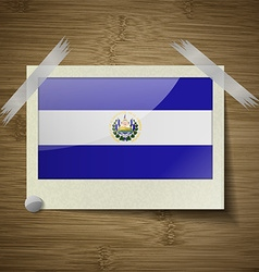 Flags El Salvador at frame on wooden texture vector