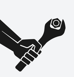hand with spanner tightening nut vector image
