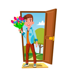 young guy in the open door with flowers and gift vector image