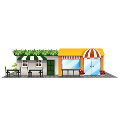 two shops with outdoor dining area vector image vector image