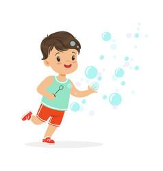 adorable little boy blowing bubbles vector image