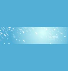 realistic snowfall against a blue vector image