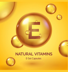 capsule with vitamin e realistic gold pill vector image