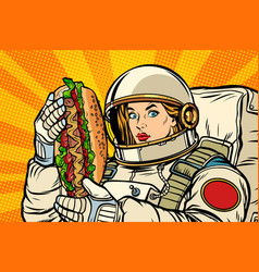 Hungry woman astronaut with hot dog vector