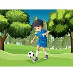 A soccer player kicking ball vector