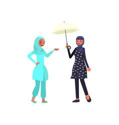 two beautiful arab girls in burkini vector image