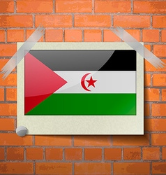 Flags Western Sahara scotch taped to a red brick vector image