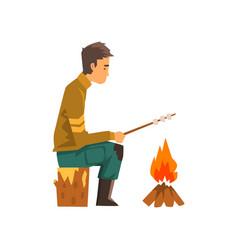 Man roasting marshmallows on campfire hiking vector