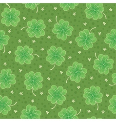 Seamless background with shamrock vector