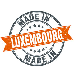 luxembourg orange grunge ribbon stamp on white vector image