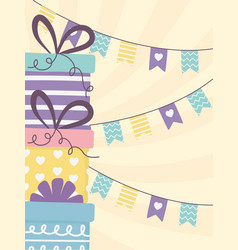 Happy day stacked gift boxes and pennants vector