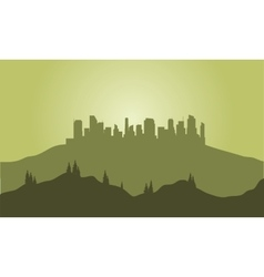 Silhouette of city on the hills vector image