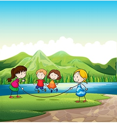 Four kids playing with a rope near the river vector image
