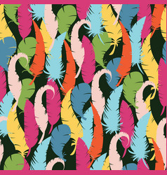 multicolored feathers on a black background vector image