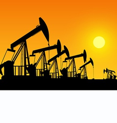 silhouette of working oil pumps on sunset backgrou vector image