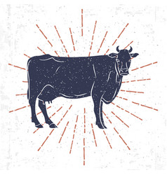Cow silhouette with vintage sunburst isolated on vector