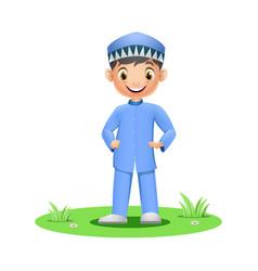 cute muslim boy standing on grass vector image