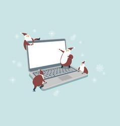 funny little santas over digital laptop computer vector image