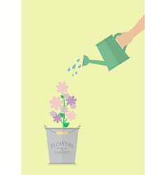 Hand watering flower in pot vector