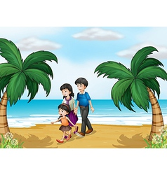 A family walking at the beach vector image