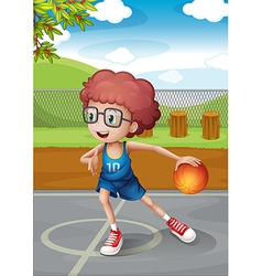 A young boy playing basketball wearing a blue vector